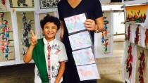 ミャンマーで子どもから絵を買う竹井佑介
